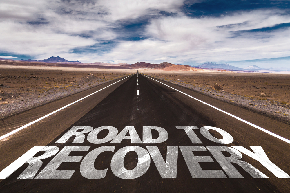 Road to Recovery written on desert road